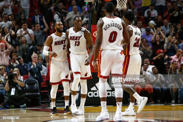 Wayne Ellington of the Miami Heat celebrates with Bam Adebayo against the Toronto Raptors during the second half at American Airlines Arena on April...