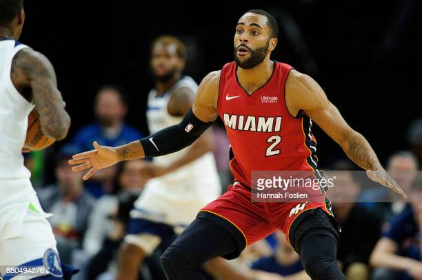 Wayne Ellington of the Miami Heat defends against the Minnesota Timberwolves during the game on November 24 2017 at the Target Center in Minneapolis...