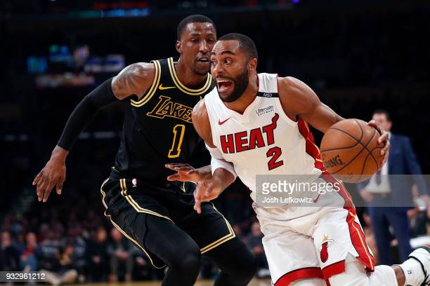 Wayne Ellington of the Miami Heat drives to the basket against Kentavious CaldwellPope of the Los Angeles Lakers during the first quarter of the game...