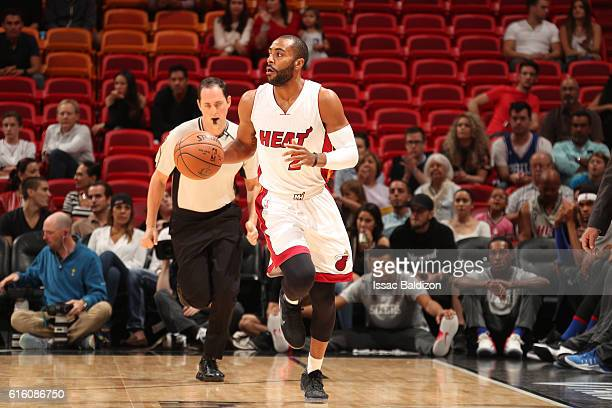 Wayne Ellington of the Miami Heat handles the ball against the Philadelphia 76ers on October 21 2016 at AmericanAirlines Arena in Miami Florida NOTE...