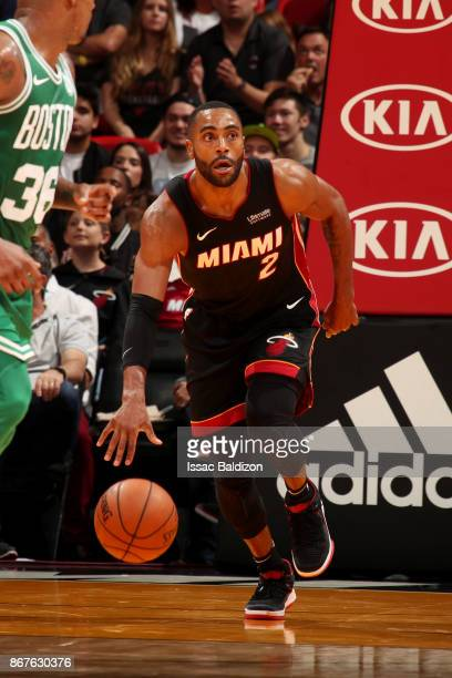 Wayne Ellington of the Miami Heat handles the ball during the game against the Boston Celtics at the American Airlines Arena on October 28 2017 in...