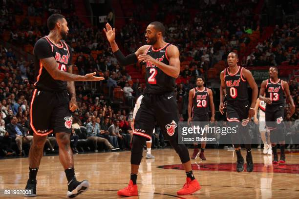 Wayne Ellington of the Miami Heat high fives teammates during the game against the Portland Trail Blazers on December 13 2017 at American Airlines...