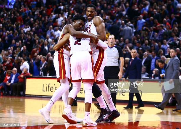 Wayne Ellington of the Miami Heat is hugged by Josh Richardson and Hassan Whiteside after he scored the winning basket with seconds to go of an NBA...