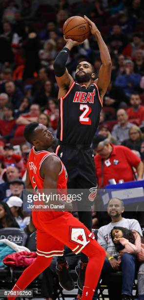 Wayne Ellington of the Miami Heat shoots over Jerian Grant of the Chicago Bulls at the United Center on November 26 2017 in Chicago Illinois The Heat...