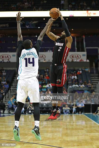 Wayne Ellington of the Miami Heat shoots over Michael KiddGilchrist of the Charlotte Hornets during their game at Spectrum Center on October 20 2016...