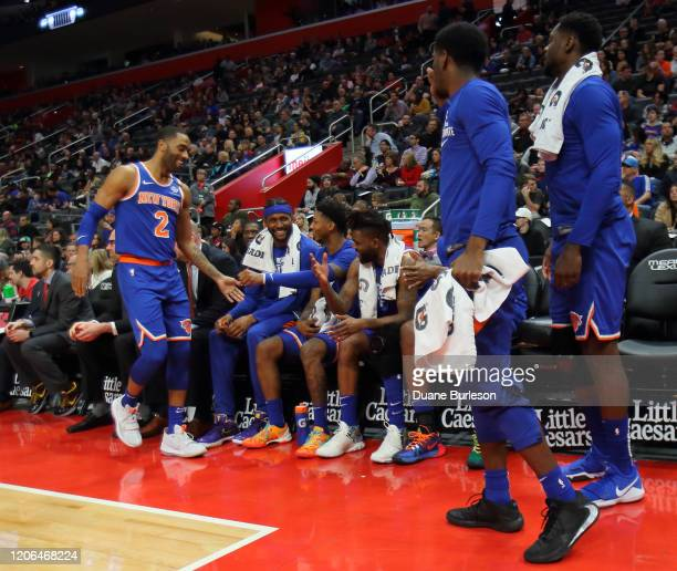 Wayne Ellington of the New York Knicks is geeted by teammates after leaving the game against the Detroit Pistons during the first half at Little...