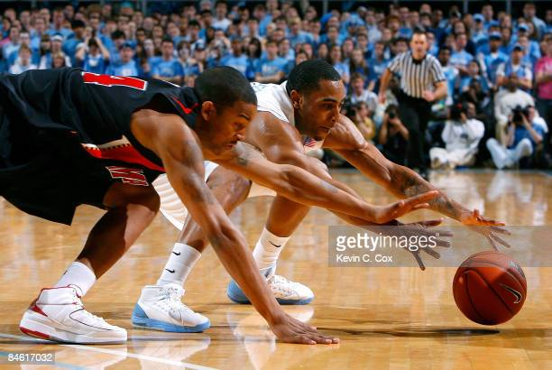 Wayne Ellington of the North Carolina Tar Heels dives for a loose ball against Cliff Tucker of the Maryland Terrapins during the game on February 3...