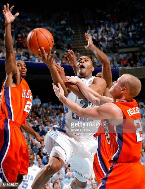 Wayne Ellington of the North Carolina Tar Heels is fouled by Terrence Oglesby of the Clemson Tigers as Demontez Stitt tries to block the shot during...