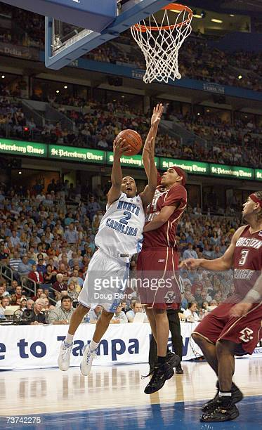 Wayne Ellington of the North Carolina Tar Heels makes a layup against Tyrelle Blair and Jared Dudley of the Boston College Eagles in the semifinals...