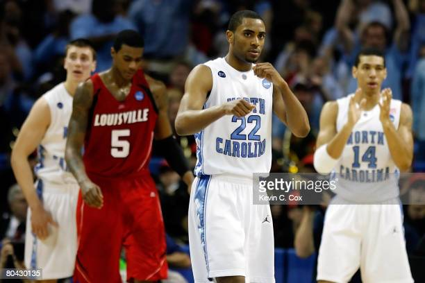 Wayne Ellington of the North Carolina Tar Heels reacts as does teammate Danny Green in the second half as Earl Clark of the Louisville Cardinals...