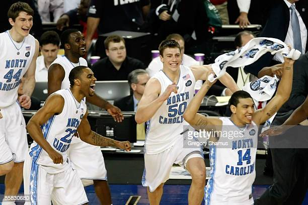 Wayne Ellington Tyler Hansbrough and Danny Green of the North Carolina Tar Heels celebrate with their teammates after they won 8972 against the...