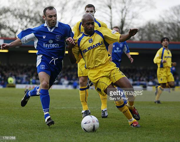 Wayne Evans of Rochdale tussles with Dean Gordon of Coventry City for possession of the ball during the FA Cup fourth round between Rochdale and...