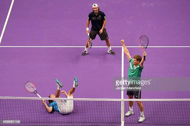 Wayne Ferreira of South Africa celebrates as Xavier Malisse of Belgium falls over the net during the Mens Doubles match between Wayne Ferreira and...