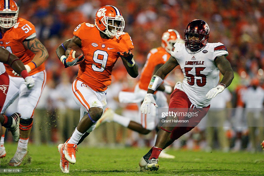 Wayne Gallman #9 of the Clemson Tigers breaks free past Keith Kelsey #55 of the Louisville Cardinals for a touchdown during the second quarter at Memorial Stadium on October 1, 2016 in Clemson, South Carolina.