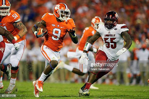 Wayne Gallman of the Clemson Tigers breaks free past Keith Kelsey of the Louisville Cardinals for a touchdown during the second quarter at Memorial...