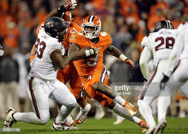 Wayne Gallman of the Clemson Tigers carries the ball during the game against the South Carolina Gamecocks at Memorial Stadium on November 26, 2016 in...