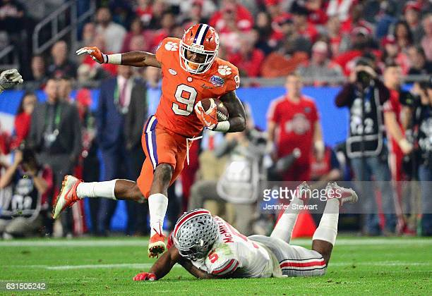 Wayne Gallman of the Clemson Tigers runs with the ball against Raekwon McMillan of the Ohio State Buckeyes during the 2016 PlayStation Fiesta Bowl at...