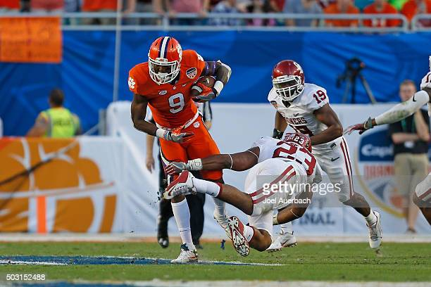 Wayne Gallman of the Clemson Tigers runs with the ball past Devante Bond of the Oklahoma Sooners during the 2015 Capital One Orange Bowl at Sun Life...