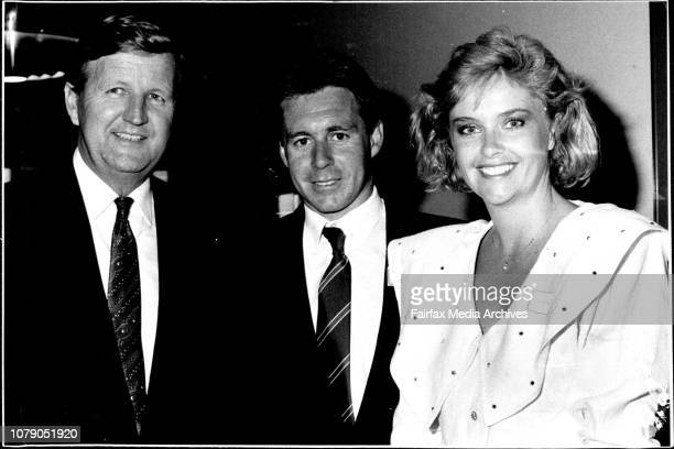 Wayne Gardner and fiancee Donna Forbes are feted by Mr Barrie Unsworth at a Premier's reception for the 500cc motor cycle world champion last night...