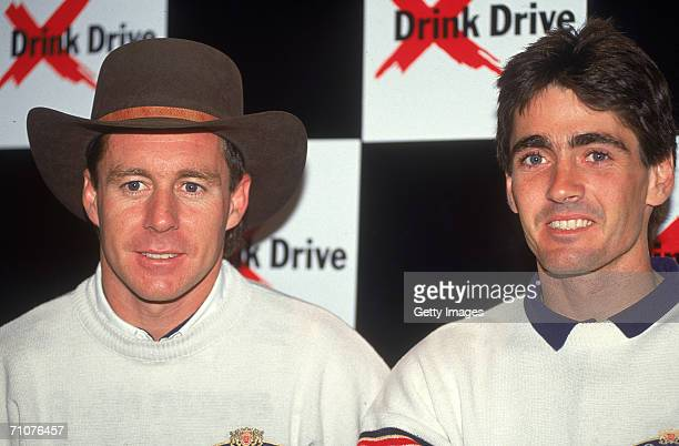 Wayne Gardner and team mate Mick Doohan of Australia for the Rothmans Honda Team addresses a press conference for the 1990 Australian Motorcycle...