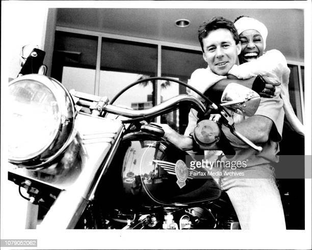 Wayne Gardner takes Chelsea Brown for a ride on his new Harley on the morning after the Tornadoes 30th birthday base at Wollongongs' Northbeach Park...