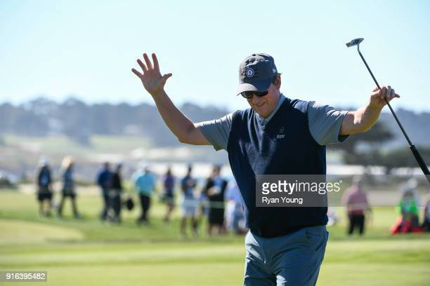 Wayne Gretzky acknowledges the crowd after making a putt during the second round of the ATT Pebble Beach ProAm at Pebble Beach Golf Links on February...