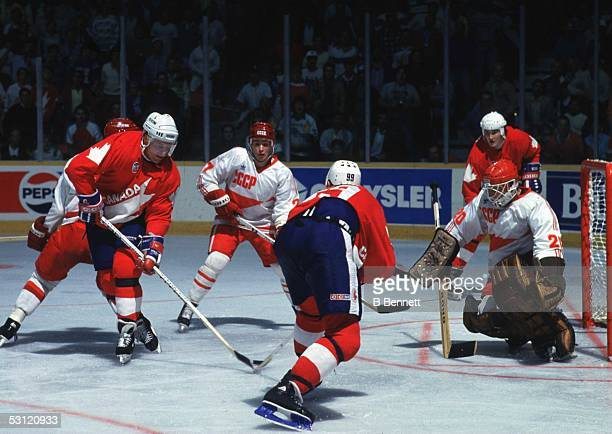 Wayne Gretzky and Brian Propp of Team Canada pass the puck to their teammate Mario Lemieux of Team Canada as Lemieux would score the game winning...