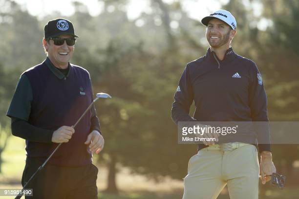 Wayne Gretzky and Dustin Johnson react on the first green during Round One of the ATT Pebble Beach ProAm at Spyglass Hill Golf Course on February 8...