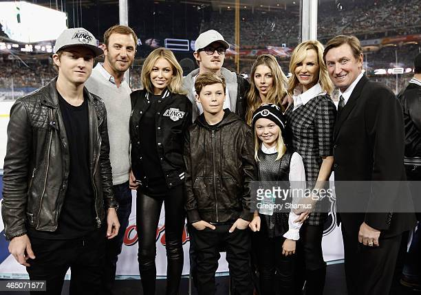 Wayne Gretzky and family pose while attending the 2014 Coors Light NHL Stadium Series between the Los Angeles Kings and the Anaheim Ducks at Dodger...