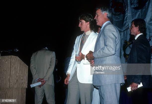 Wayne Gretzky and Gordie Howe look on before the 1983 NHL Awards Banquet circa 1983
