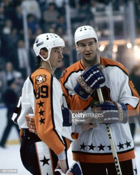 Wayne Gretzky and Kevin Lowe both of the Campbell Conference and the Edmonton Oilers talk during the 1988 39th NHL All-Star Game against the Wales...