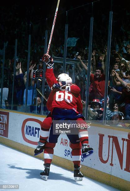 Wayne Gretzky and Mario Lemieux of Team Canada celebrate Lemieux's second goal of the game for a 54 lead during Game 2 of the 1987 Canada Cup on...