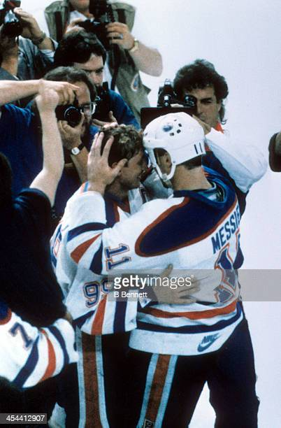 Wayne Gretzky and Mark Messier of the Edmonton Oilers embrace each other after Game 7 of the 1987 Stanley Cup Finals against the Philadelphia Flyers...