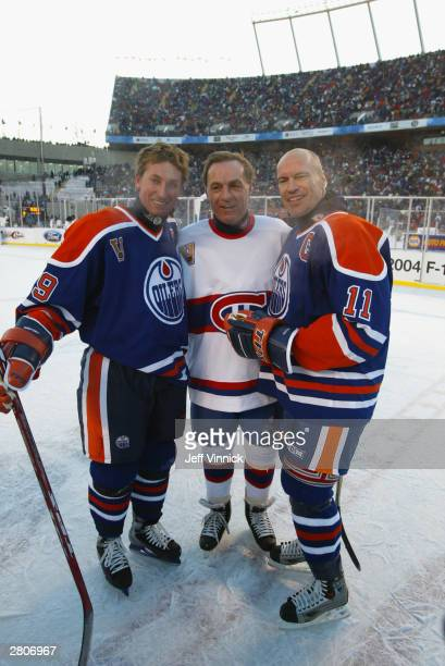 Wayne Gretzky and Mark Messier of the Edmonton Oilers pose for a photo with Guy Lafleur of the Montreal Canadiens after the Molson Canadien Heritage...