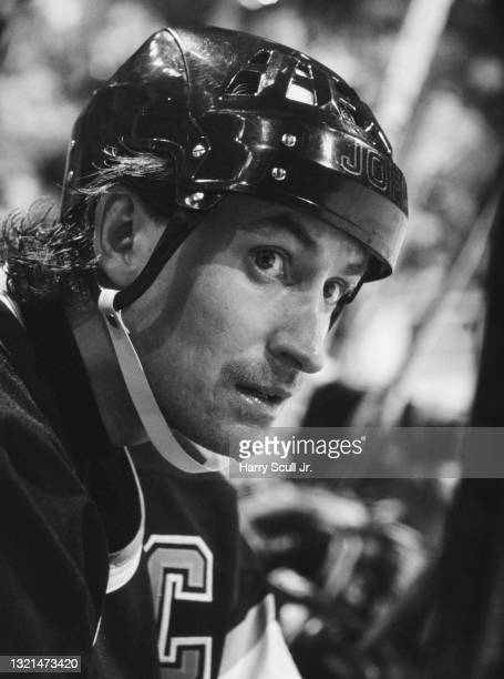 This image has been converted to black and white) Wayne Gretzky, Captain and Center for the Los Angeles Kings looks on from the bench during the NHL...