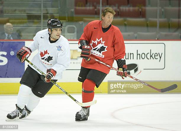 Wayne Gretzky, Executive Director of Team Canada, skates beside Patrick Marleau of Team Canada during a practice session before Canada's exhibition...