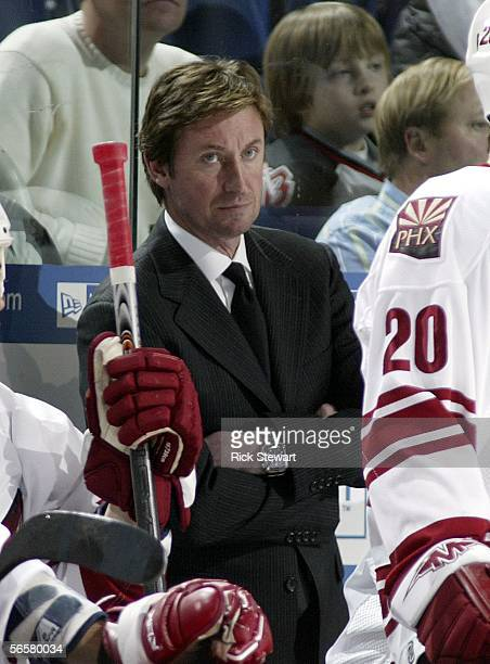 Wayne Gretzky, head coach of the Phoenix Coyotes watches play against the Buffalo Sabres on January 12, 2006 at HSBC Arena in Buffalo, New York.