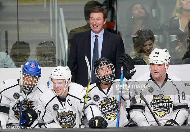 Wayne Gretzky laughs behind the bench during the 2017 NHL AllStar Celebrity Shootout as part of the NHL AllStar Weekend at Staples Center on January...
