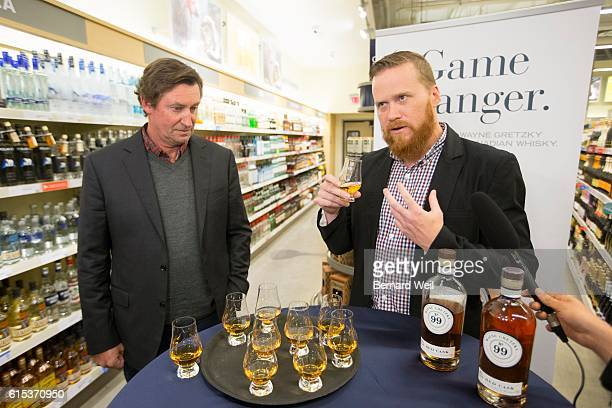 TORONTO ON OCTOBER 17 Wayne Gretzky launched his new No 99 Canadian Whisky at the Maple Leaf Square LCBO along with Joshua Beach master distiller