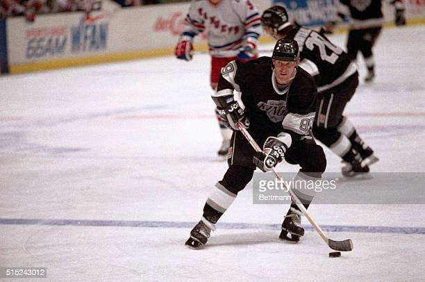Wayne Gretzky Los Angeles Kings' superstar stick handles the puck as he heads down the ice during the NHL game here 12/12 against the New York...