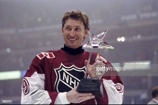 Wayne Gretzky of North American and the New York Rangers poses with the MVP Award after the 1999 49th NHL AllStar Game against the World on January...