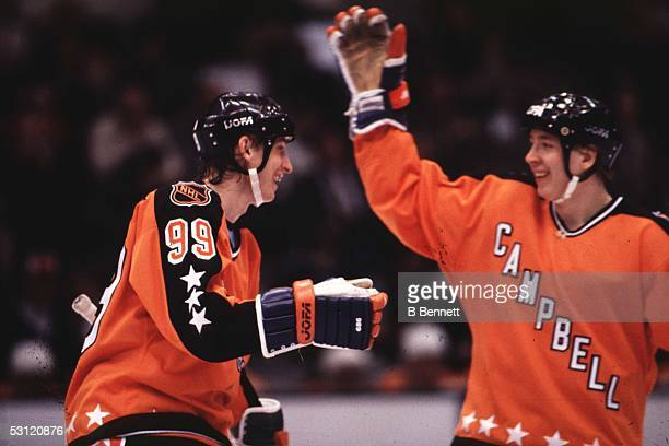 Wayne Gretzky of the Campbell Conference and the Edmonton Oilers celebrates with teammate Jari Kurri during the 1983 35th NHL All-Star Game against...