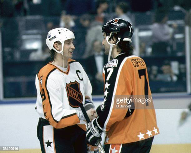 Wayne Gretzky of the Campbell Conference and the Edmonton Oilers shakes hands with Paul Coffey of the Wales Conference and the Pittsburgh Penguins...