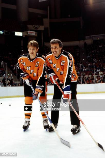 Wayne Gretzky of the Campbell Conference and the Edmonton Oilers poses with honorary captian Phil Esposito before the 1986 38th NHL AllStar Game...