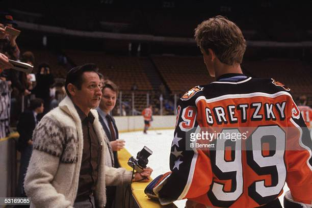 Wayne Gretzky of the Campbell Conference and the Edmonton Oilers talks to his father Walter before the 1984 36th NHL All Star Game against the Wales...