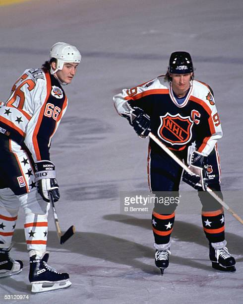 Wayne Gretzky of the Campbell Conference and the Los Angeles Kings is defended by Mario Lemieux of the Wales Conference and the Pittsburgh Penguins...