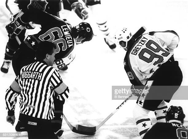 Wayne Gretzky of the Campbell Conference and the Los Angeles Kings facesoff against Mario Lemieux of the Wales Conference and the Pittsburgh Penguins...