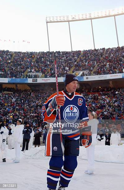 Wayne Gretzky of the Edmonton Oilers acknowledges the fans as he skates into the rink to take on the Montreal Canadiens during the Molson Canadien...