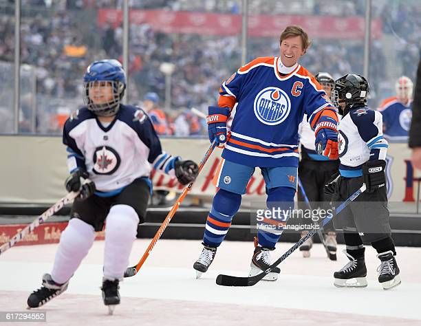 Wayne Gretzky of the Edmonton Oilers alumni plays with kids from the TimBits Hockey Program during the 2016 Tim Hortons NHL Heritage Classic alumni...