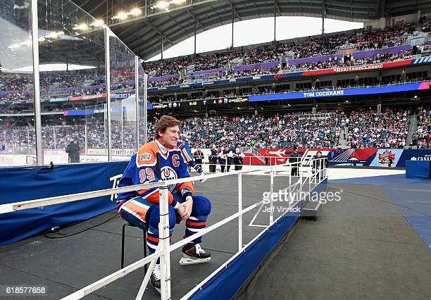 Wayne Gretzky of the Edmonton Oilers alumni rests during an intermission of the 2016 Tim Hortons NHL Heritage Classic Alumni Game against the...